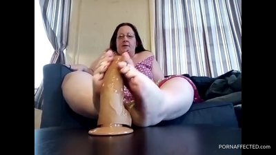 Amateur chubby mom performs footjob on..