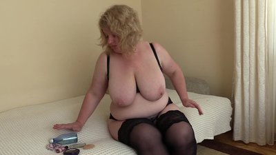 A mature milf with big tits, pushes a..