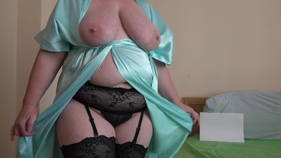 A mature woman with big tits and a..