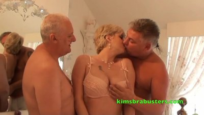 Two guys finishing a blonde mature